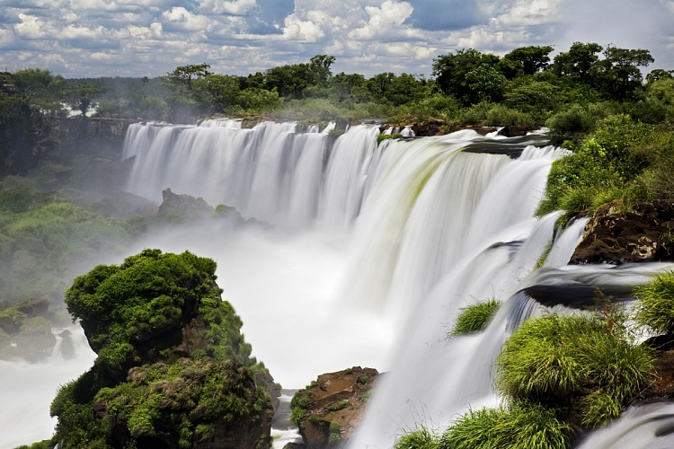 Tourists Shower the Iguazu Falls with Coins